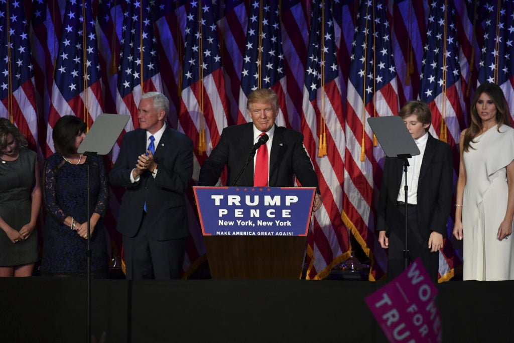 President-elect Donald Trump, with his family, addresses supporters at an election night event at the New York Hilton Midtown November 8, 2016 in New York City, New York.